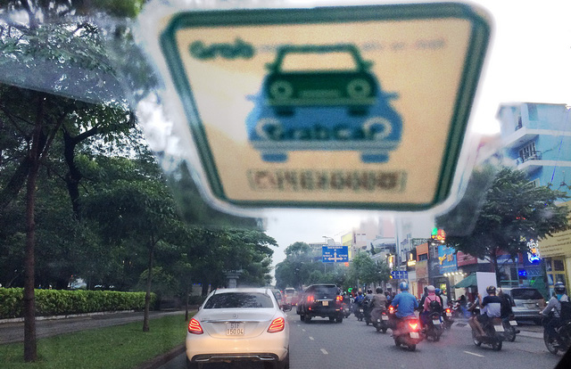 TP.HCM có 24.000 xe Grab và Uber hoạt động - Ảnh 1.