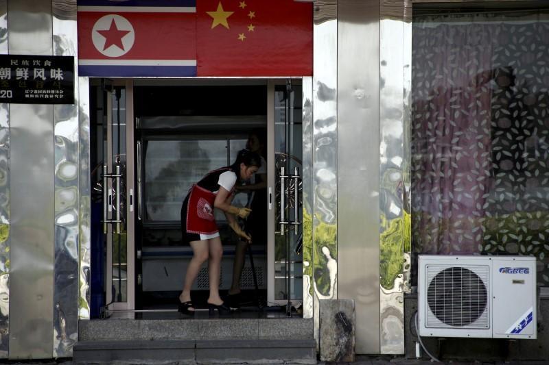 Nhiều ngân hàng Trung Quốc ngoảnh mặt với người Triều Tiên - Ảnh 1.