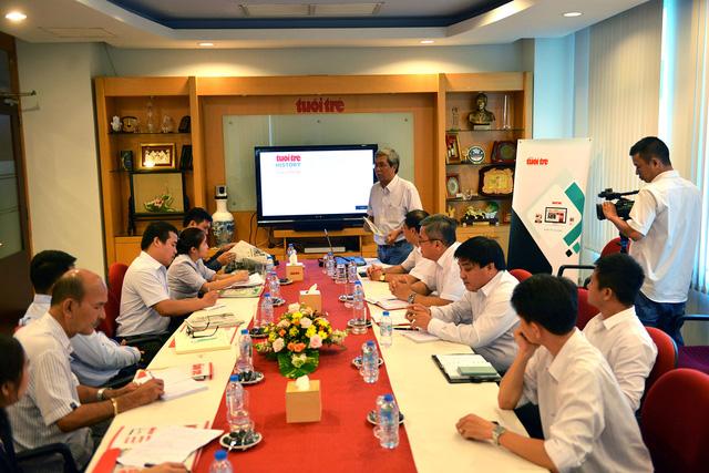 Đoàn nhà báo Lào tham quan báo Tuổi Trẻ - Ảnh 2.