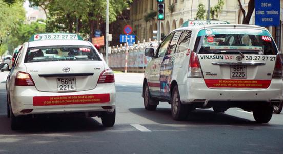Uber và Grab có thể kiện ngược tài xế xe Vinasun? - Ảnh 1.