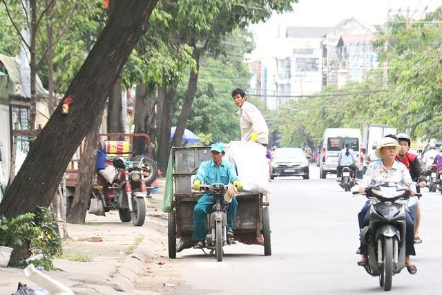 Dân TP.HCM sẽ đóng tiền rác cao hơn từ tháng 11 - Ảnh 1.