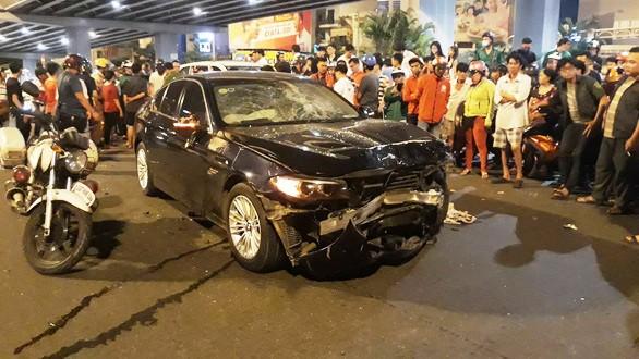 Khởi tố, bắt tạm giam nữ lái xe BMW tông hàng loạt xe máy - Ảnh 1.