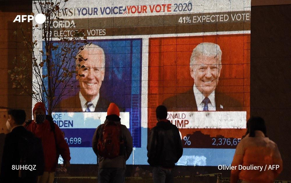 Ông Biden dẫn trước sít sao ở Michigan, dự đoán thắng ở Wisconsin - Ảnh 1.