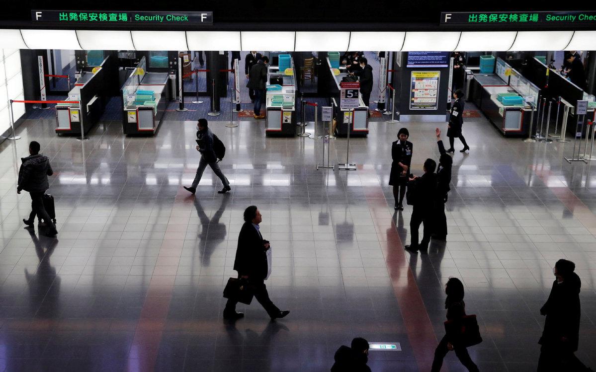 Khu vực kiểm tra an ninh tại sân bay Haneda ở Tokyo, Nhật Bản - Ảnh: REUTERS