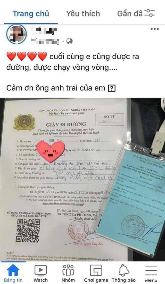 Khoe giấy đi đường được chạy vòng vòng lên Facebook, tình nguyện viên bị thu hồi giấy - Ảnh 1.