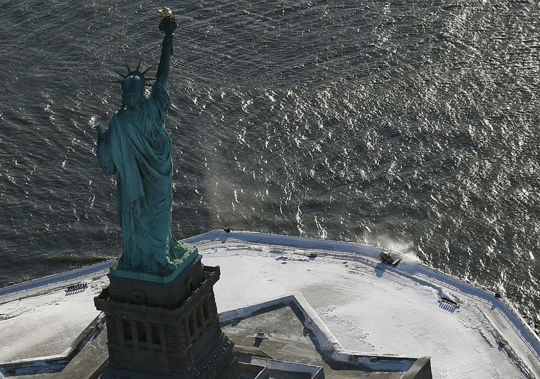 Thế giới trong tuần qua ảnh: 'bom bão' phủ tuyết lên nước Mỹ - Ảnh 4.