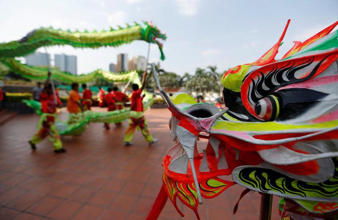 Xem các nước châu Á đón Tết qua ống kính Reuters - ảnh 5