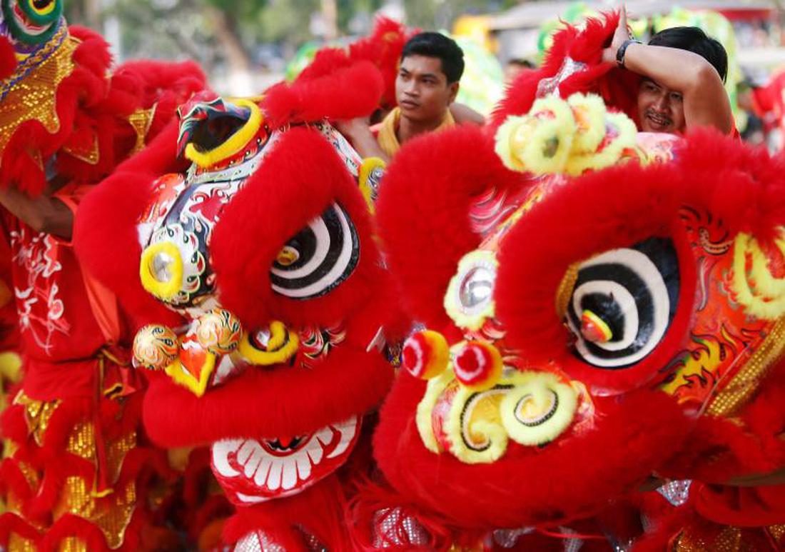 Xem các nước châu Á đón Tết qua ống kính Reuters - ảnh 4