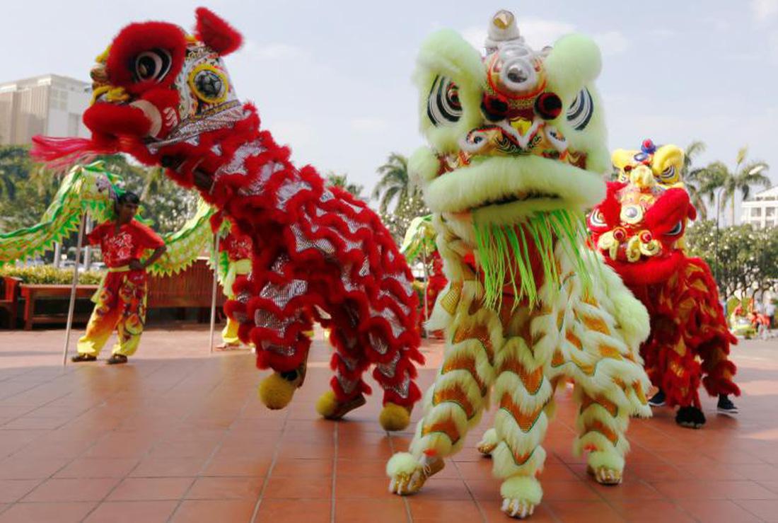 Xem các nước châu Á đón Tết qua ống kính Reuters - ảnh 6