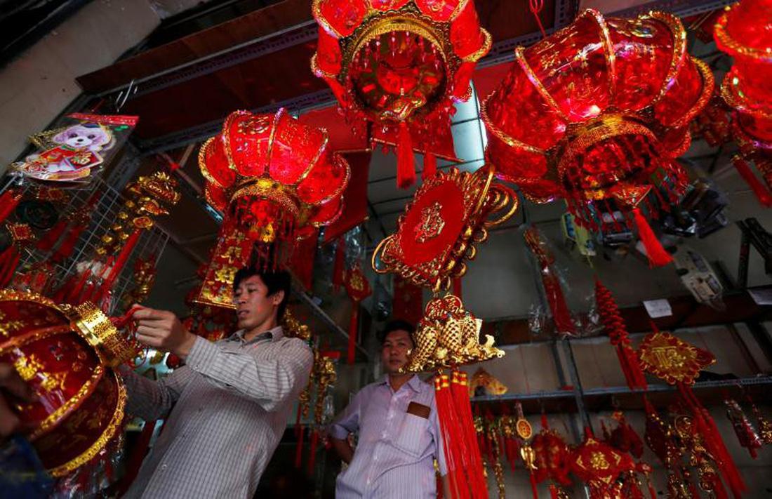 Xem các nước châu Á đón Tết qua ống kính Reuters - ảnh 1