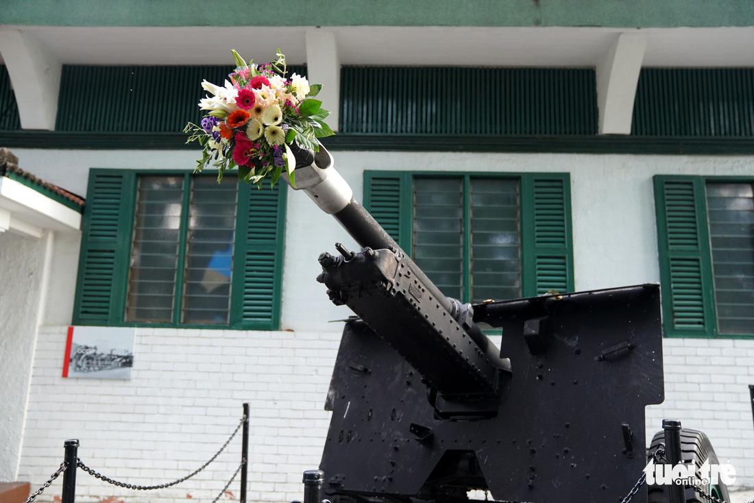 Những bông hoa trên nòng súng ở hội đàm Trump - Kim - Ảnh 9.