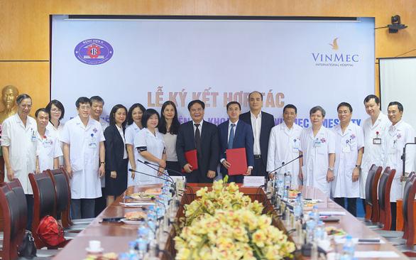 Bệnh viện K hợp tác Vinmec điều trị ung thư - Ảnh 2.