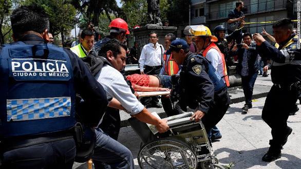Động đất lớn ở Mexico, hơn 110 người chết - Ảnh 4.