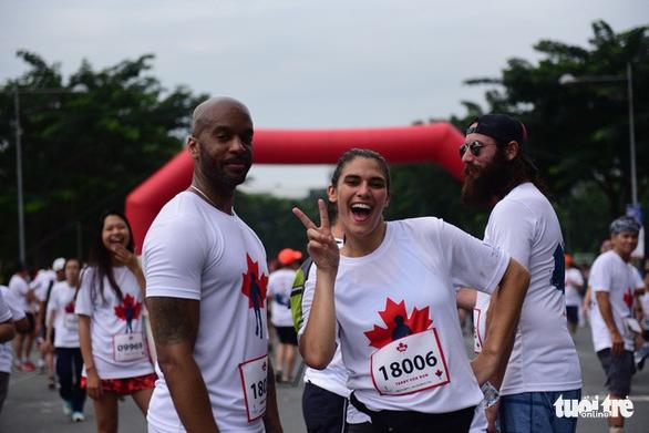 Gần 20.000 người tham gia chạy bộ từ thiện tại TP.HCM - Ảnh 3.