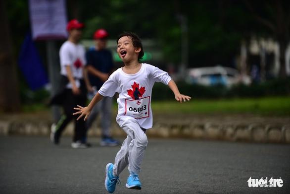 Gần 20.000 người tham gia chạy bộ từ thiện tại TP.HCM - Ảnh 6.
