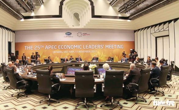 Các nhà lãnh đạo kinh tế bắt đầu phiên họp quan trọng nhất APEC - Ảnh 1.