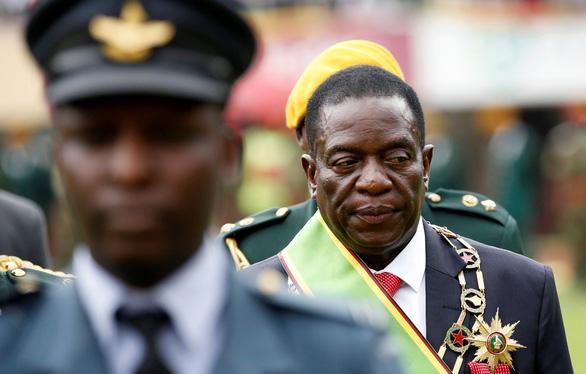 Thế giới qua ảnh: Chuyển giao quyền lực ở Zimbabwe, Đức nguy cơ bầu cử lại - Ảnh 3.