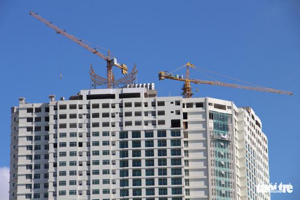 Mường Thanh Khánh Hòa cắt ngọn xong 3 tầng xây vượt - Ảnh 5.