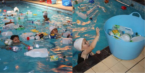 Trường cho học sinh bơi trong bể ô nhiễm để dạy về rác nhựa - Ảnh 2.