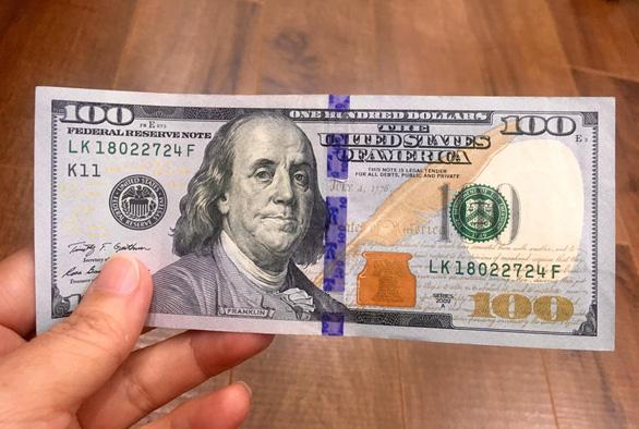 Đổi 100 USD tại tiệm vàng, bị phạt 90 triệu đồng - Ảnh 1.