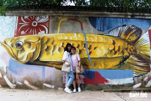 Con đường graffiti hút hồn bạn trẻ xứ Huế - Ảnh 5.