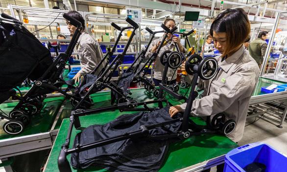 Hãng tin Đức: Việt Nam đang có lợi trong cuộc chiến thương mại Mỹ - Trung - Ảnh 1.