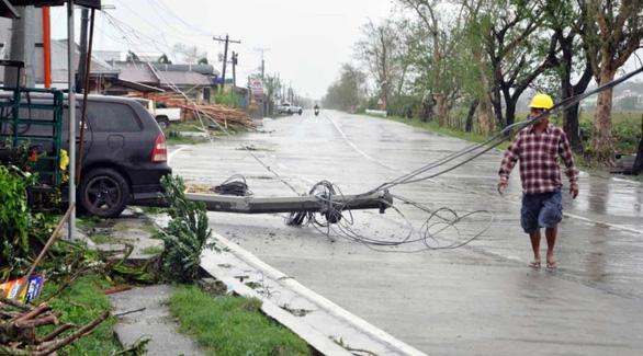 Ít nhất 30 người Philippines bị vùi lấp do bão Yutu - Ảnh 1.