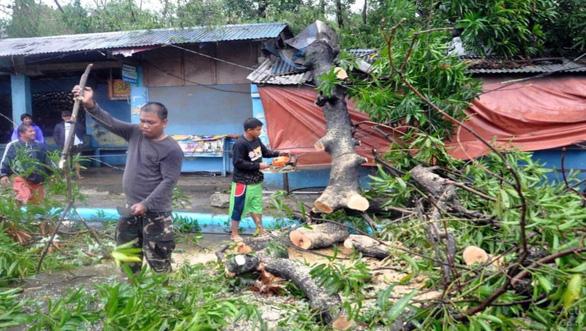 Ít nhất 30 người Philippines bị vùi lấp do bão Yutu - Ảnh 2.