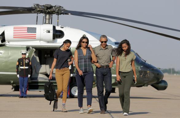 Michelle Obama tiết lộ đã thụ tinh trong ống nghiệm để sinh 2 con gái - Ảnh 2.