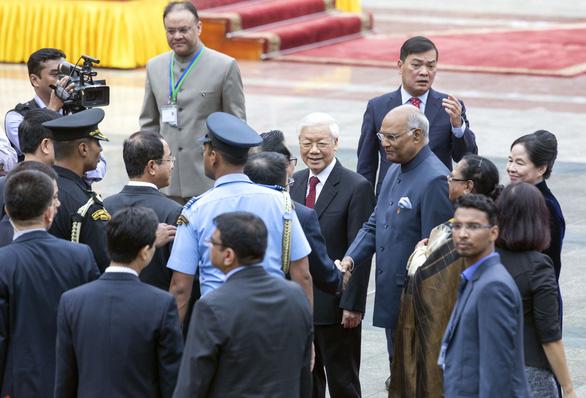 Chủ tịch nước Nguyễn Phú Trọng đón tiếp Tổng thống Ấn Độ Kovind - Ảnh 3.