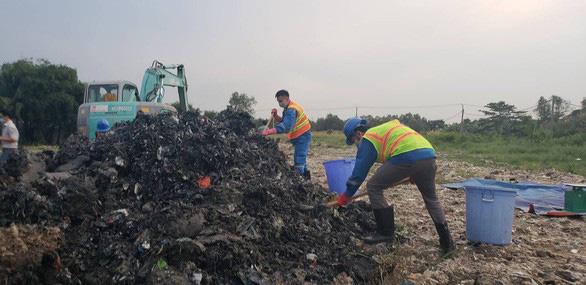 Ít nhất 15.000m3 chất thải đã được đem... san lấp mặt bằng - Ảnh 1.