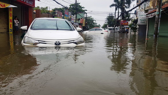 Xe bị thiệt hại do mưa bão, đền bù được không? - Ảnh 1.
