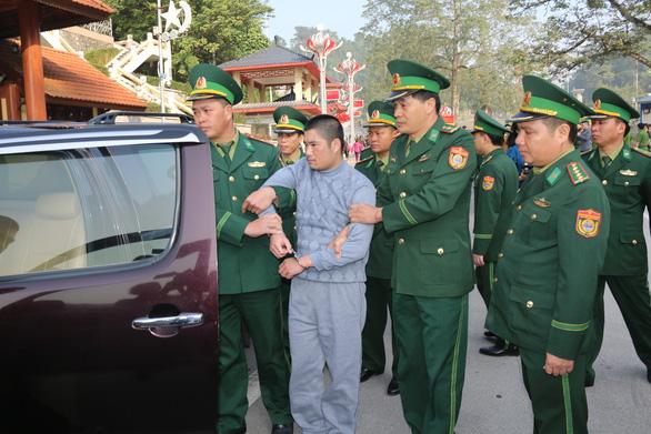 Trung Quốc bàn giao tội phạm truy nã quốc tế cho Việt Nam - Ảnh 1.
