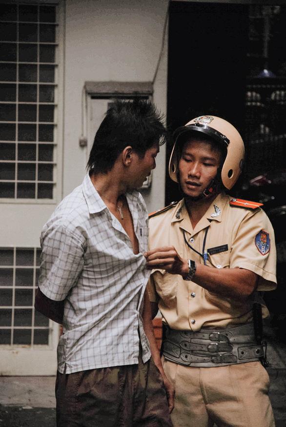 Gặp CSGT bắt cướp trong bộ ảnh nổi tiếng 11 năm trước - Ảnh 5.
