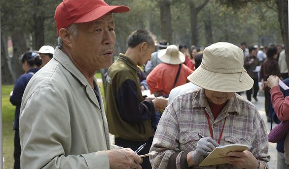 Cha mẹ Trung Quốc 'giải ế' cho con cái ở chợ hôn nhân  - Ảnh 4.