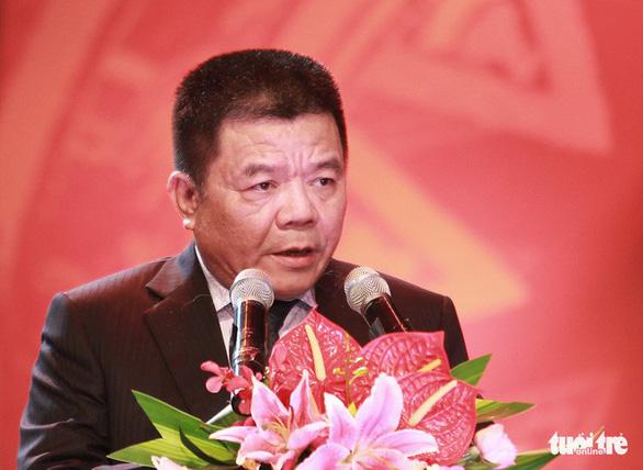 Bắt ông Trần Bắc Hà, cựu chủ tịch Ngân hàng BIDV - Ảnh 1.