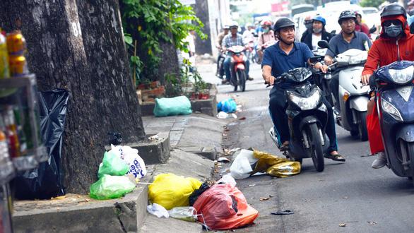 Quyết liệt, bền bỉ để có thành phố sạch đẹp - Ảnh 1.