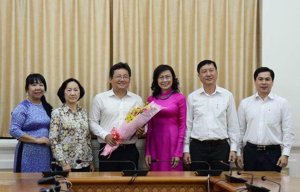Phê chuẩn kết quả bầu chủ tịch UBND quận 1, huyện Hóc Môn - Ảnh 3.