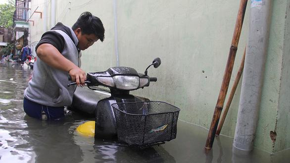 Cứ mưa là ngập, các đô thị lớn phải xem lại quy hoạch - Ảnh 2.