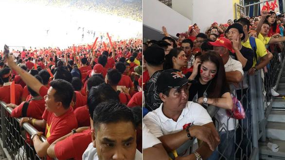 CĐV Việt Nam bị chơi xấu trên khán đài Bukit Jalil - Ảnh 1.