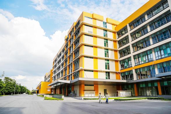 Bình Dương & Đại học Quốc gia TP.HCM: Bắt tay hợp tác phát triển  giáo dục, y tế - Ảnh 1.
