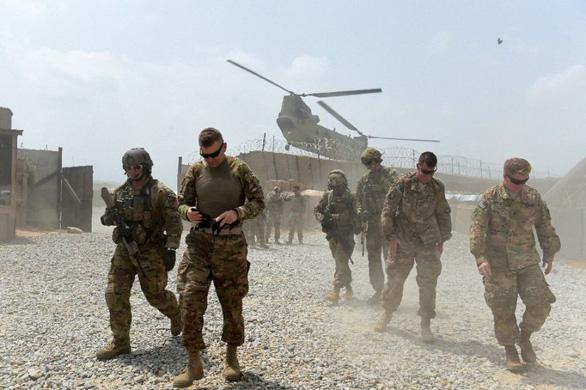 Mỹ rút, NATO vẫn cam kết nhiệm vụ tại Afghanistan - Ảnh 1.