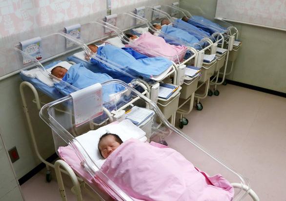 Sinh thêm con: một lựa chọn khó khăn - Ảnh 2.