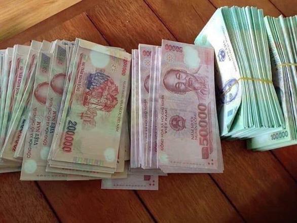 Bao lì xì in hình tiền Việt Nam liệu có vi phạm pháp luật - Ảnh 2.