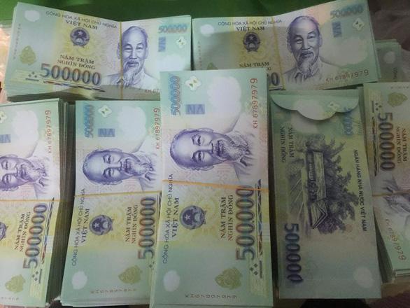 Bao lì xì in hình tiền Việt Nam liệu có vi phạm pháp luật - Ảnh 1.