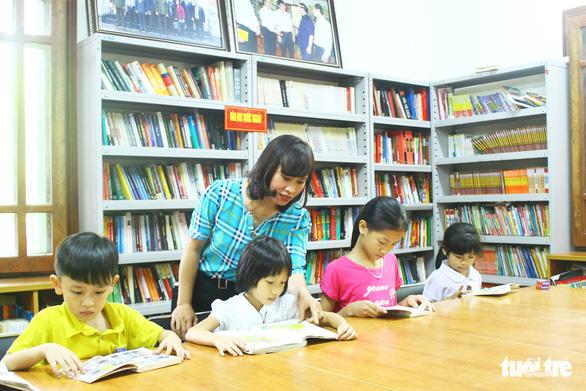 Thư viện Làng Sen lan tỏa văn hóa đọc trên quê Bác - Ảnh 1.
