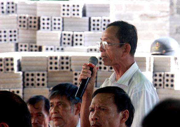 Dân giữ người để phản đối dự án điện mặt trời tại Bình Định - Ảnh 1.