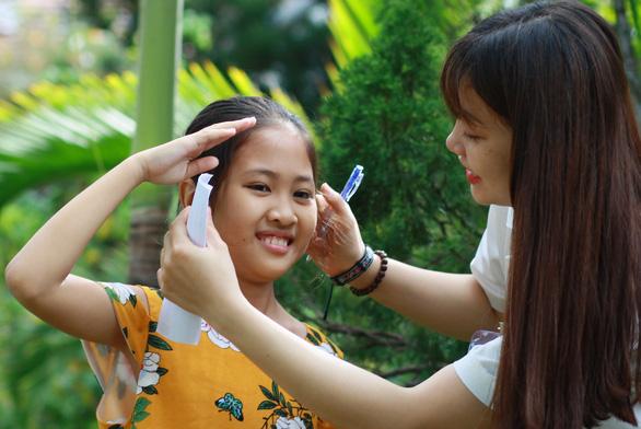 750 ảnh chân dung trẻ em và bệnh nhân ung bướu  xúc động - Ảnh 3.