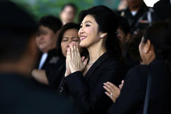 Bà Yingluck đã qua Nhật, sẽ họp báo tại Hong Kong - Ảnh 1.