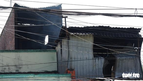 Tiệm sửa xe khóa kín cửa cháy rụi ngày mùng 3 tết - Ảnh 7.
